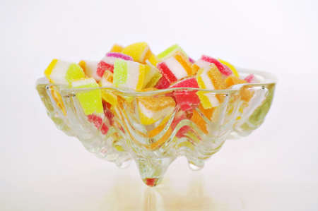 Multicolored fruity gummy jelly candies in glass bowl isolated on white background Stok Fotoğraf