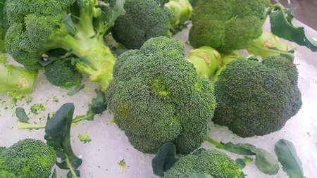 Close up of photo of very fresh colorful broccoli in  a market