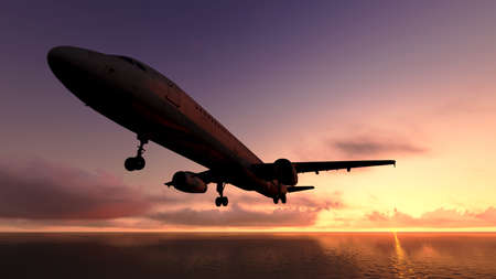 The plane was flying over the ocean on sunset Stock Photo - 23435147