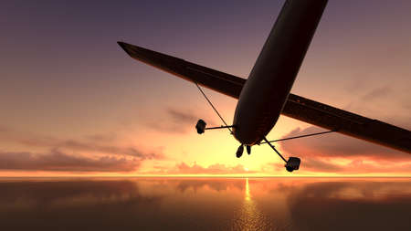 The plane was flying over the ocean on sunset Stock Photo - 23457023