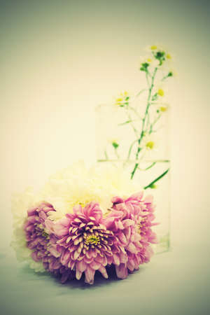 Bouquet of Flowers in a Glass on Vintage background photo
