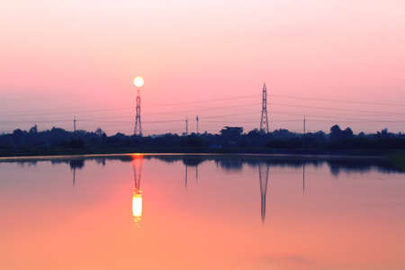 telephone poles: telephone poles on sunset at the river Stock Photo