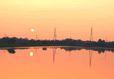 telephone poles on sunset at the river 版權商用圖片