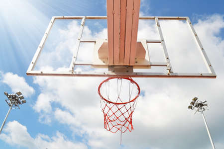Basketball hoop in the blue sky photo
