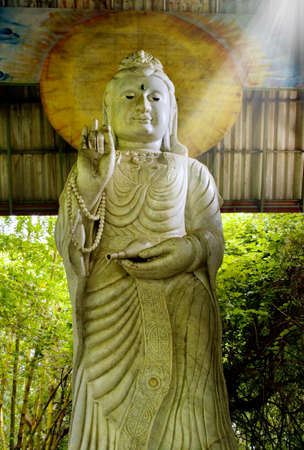 bodhisattva: Statue of Bodhisattva Kuan on a lotus. Statues in public places at the temple.