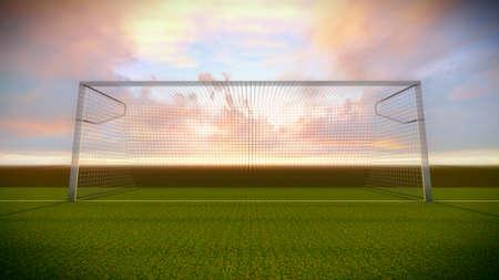 Voetbal doel op het voetbalveld bij zonsondergang.