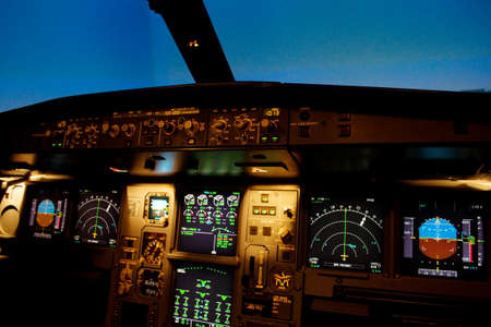 avionics: Light from a plane control  room in the dark.