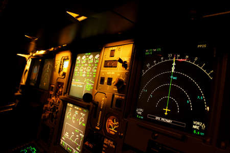 Light from a plane control  room in the dark. photo