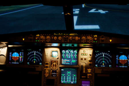 Light from a plane control  room in the dark.
