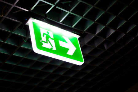 Fire exit signs in the building. 版權商用圖片