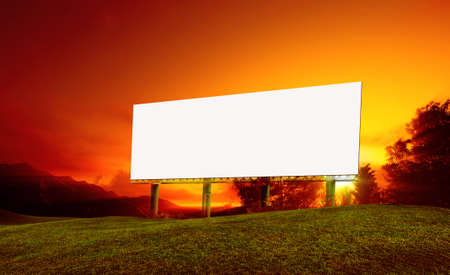 Tall billboards for advertising with sunset.
