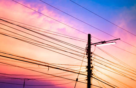 electricity pole: electricity poles at sunset with colorful cloud