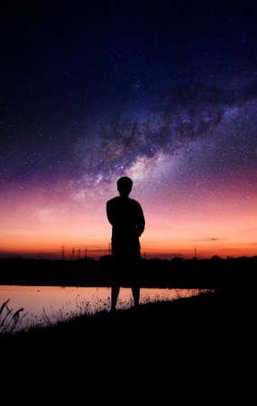 interstellar: silhouette of shadow man with interstellar in the sky