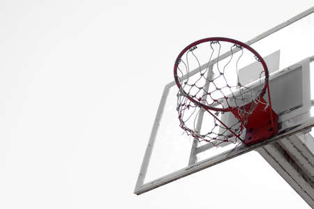 hoop: Basketball hoop in outdoor basketball field with blue sky