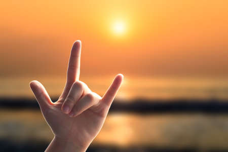 show of hands: Show hands, Love sign on beach of sea blur with sunset
