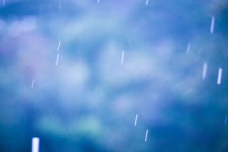 raining background: blur raining background with light nature bokeh and vintage color tone