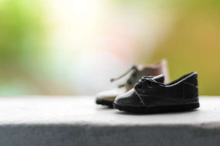 litle: Little Shoes in rainy season and blur nature background with vintage tone Stock Photo