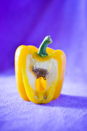 bell peper: still light photography of yellow sweet pepper on fabric background