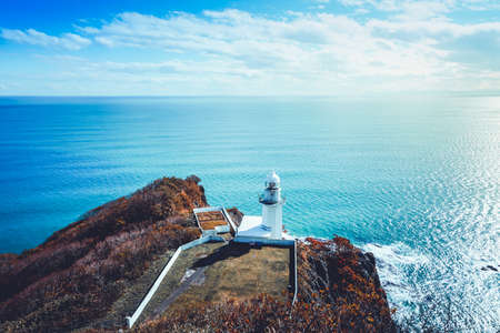 Lighthouse and ocean with blue sky at cape Chikyu Hokkaido Japan