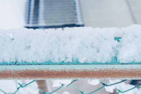 Snow on metal net at park for background Standard-Bild - 126281106