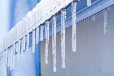 Icicle melt is hanging from a roof