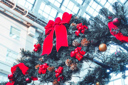Ribbon tied on Christmas tree for the archway corridor