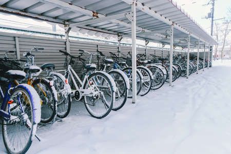 bicycle in the garage full of snow