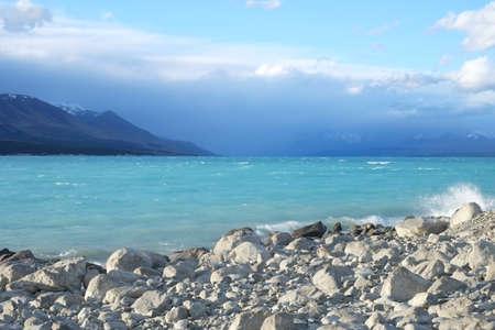 Blue lake with cloudy sky Reklamní fotografie