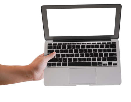 Hand of a man holding a metallic computer laptop with blank screen. Isolated on white background.