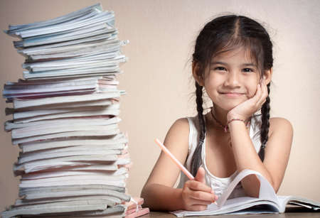 8 10 years: Kids are doing homework   Stock Photo