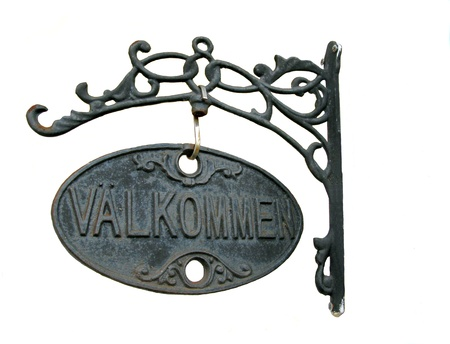 Metal plate with the word  Wellcome  in Swedish photo