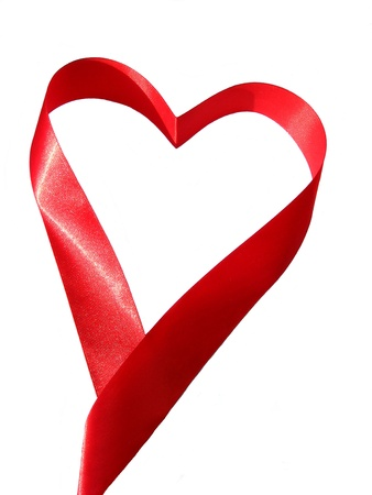 Heart made of red silky ribbon photo