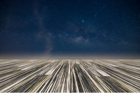 Milky way star galaxy sky night backglound with wooden floor Reklamní fotografie