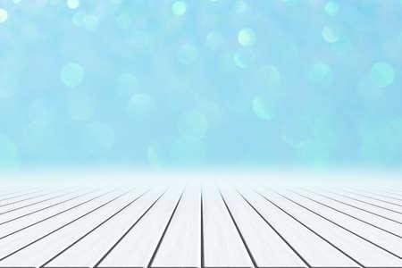 White wood floor Blue bokeh background Reklamní fotografie