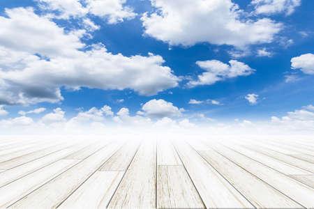 Sky background with wooden floor