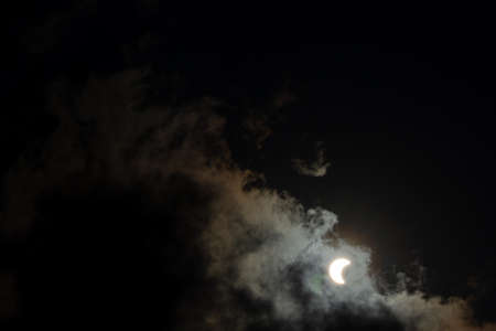 Solar Eclipse with Clouds in the Sky Standard-Bild
