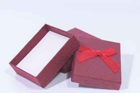Dark red gift box In the white background