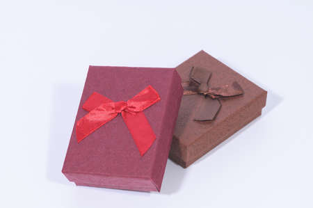 Dark red gift box collection in the white background