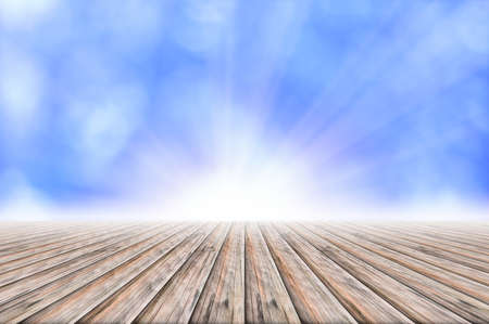 Wooden floor, light blue bokeh background with light beam