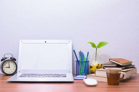 concept of computers in business earns money at the desk