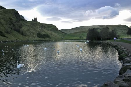 St Margarets Loch in Holyrood Park, Edinburgh, Scotland with St Anthony Chapel and the rear of Salisbury Crags photo