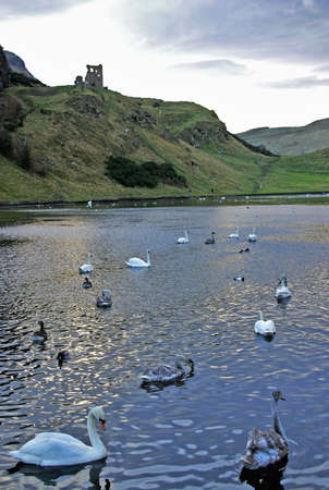 Ruins of St Anthony Chapel and St Margaret Loch in Holyrood Park, Edinburgh, Scotland photo