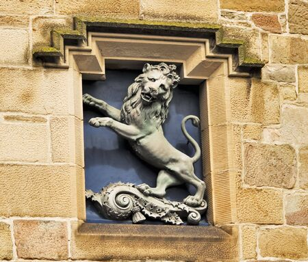 rampant: Lion Rampant set in building alcove Stock Photo