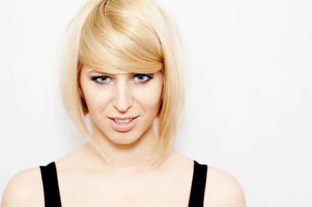 sensually: Portrait of a beautiful woman with blonde hair looking sensually.