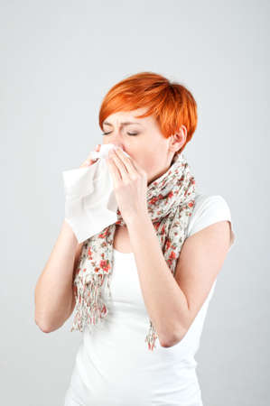 Sneezing woman with a handkerchief photo