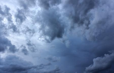 stomy: sunlight behind  storm clouds