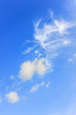 puffy white cloud on blue sky background