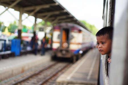 penury: child in train Editorial