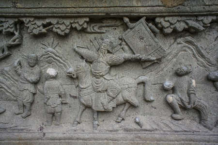 Stone carving Chinese art around Thai temple Bangkok Thailand photo