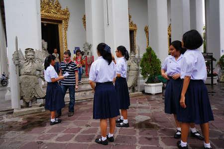 studens: Bangkok, Thailand - September 10   students are Recording presentations at Wat Arun on August 2, 2013 in Bangkok, Thailand Editorial
